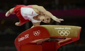 Igor Pakhomenko of Russia competes in the vault event during the men's gymnastics qualification during the London 2012 Olympic Games